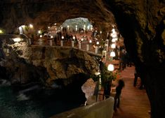 In the town of Polignano a Mare in southern Italy (province of Bari, Apulia), lies a most unique dining experience at the Grotta Palazzese. Open only during the summer months, a restaurant is created inside a vaulted limestone cave, looking outwards toward the sea.