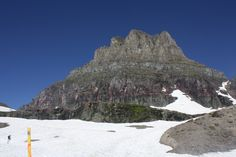 Cobalt blue sky, ash gray mountain, white snow. Glacier National Park, Montana