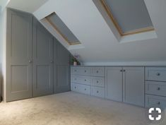 Significance of shaker style fitted bedroom furniture Fitted wardrobes built into loft conversion. Storage drawer units shaker style doors and drawers. Pull out hanging rails. furniture layout windows Significance of shaker style fitted bedroom furniture Attic Loft, Loft Room, Attic Rooms, Bedroom Loft, Attic Bedroom Storage, Garage Attic, Attic Bedroom Closets, Attic Playroom, Attic Stairs