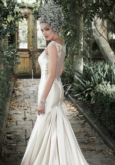 Maggie Sottero Delphina Wedding Dress - The Knot  Not too sure about the dress, but I like how it is fitted at the hips, but then is more roomy in the legs