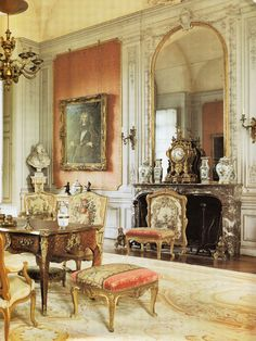 Early 18th century Rococo style this room is so wonderful. You can notice the full Rococo style element used in the dining table and fireplace. This room features pale colours and elegance. Wooden panelled walls were an easy way for them to re design the interior instead of rebuilding everything. Also recognising the Rococo style chairs which I often still see in todays interiors.