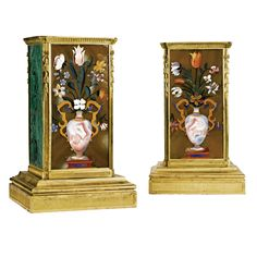 A pair of Restauration ormolu-mounted, pietra dura and malachite plinths circa 1820-30 each with a rectangular molded frieze above a rectangular plinth with concave corners fitted with pendant ribbon-tied husks, the pietre dura-decorated front incorporating an onyx vase with a tulips, roses, daffodils, magnolia and other flowers, the sides and the reverse with malachite panels, above a stepped ormolu base. One corner mount replaced; originally the plinths for a vases or candelabra.