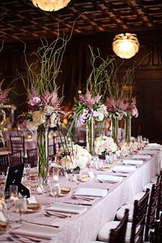 Tall centerpieces- curly willow for height with flowers at the base.  Your colors would be similar with the majority being muted colors, and accents of plums, peach and purple.