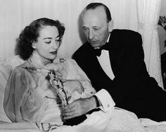 Joan Crawford feeling a little under the weather accepts her Oscar for 'Mildred Pierce' 1945