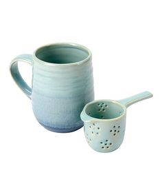 Treat yourself to a hot mug of tea with this mug set that includes an infuser that fits snugly inside.