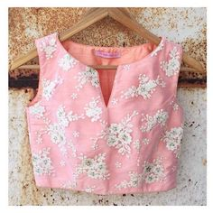 Peach art silk blouse with embroidered net overlay. Best worn with pallazos, pencil skirts and saris. This item will take 2 weeks for delivery Dry Clean Only