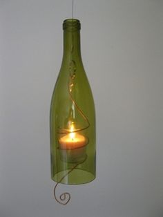 Hanging wine bottle candles are made from recycled wine bottles and salvaged electrician's copper. ++ More information at Teena Stewart website ! Idea sent by Teena Stewart ! Wine Bottle Candle Holder, Wine Bottle Corks, Wine Bottle Crafts, Candle Holders, Bottles And Jars, Glass Bottles, Gin Bottles, Glass Beads, Recycled Wine Bottles