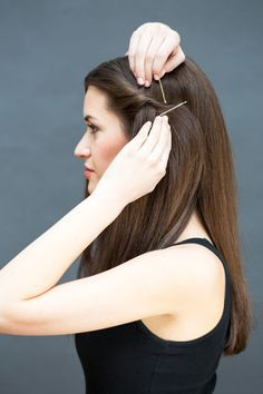"""Secure the section with a bobby pin placed at a diagonal. Then place a second pin criss-crossed over the first to create an X-shape. """"I like to show the pins—not hide them—so that they're an accessory,"""" says Peña."""