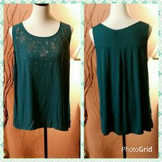 Turquoise green sleeveless top. Beautiful light weight sleeveless top.  In a beautiful dark turquoise green color. With gunmetal studs and accents on the front.  New with tag.  Size is 0X which is in between XL and 1X. Apt. 9 Tops Camisoles