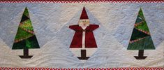 Whodda thunk? I've actually completed a holiday table runner with my paper-pieced Santa blocks.  Yes, it's December 28, but 48 hours or so from Christmas counts, doesn't it? It certainly helps to h...