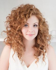 Curly Hair With Bangs - I like this, but the curls may be bigger than you have, if they aren't artificially created. The style looks the same as you have been pinning, but longer.