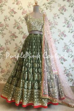 Lehenga Choli are the most preferred Indian Ethnic Wear for Woman. This Mehandi Green Lucknowi Lehenga Gold Choli Pink Dupatta can uplift your style. Lehenga Gown, Lehnga Dress, Party Wear Lehenga, Anarkali, Beautiful Pakistani Dresses, Pakistani Bridal Dresses, Indian Dresses, Indian Wedding Outfits, Indian Outfits