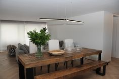 Our Swan pendant lamp in walnut in a private penthouse in Fresnaye, Cape Town. Dining Table, Table Lamp, Lighting Concepts, Luminaire Design, Led, Wooden Tables, Scandinavian Design, Pendant Lamp, Chair Design