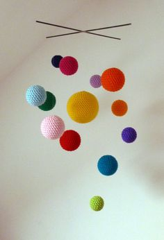 Cute mobile!  Cosmos crochet mobile handmade for baby's room by bubblewrapdesign. Etsy