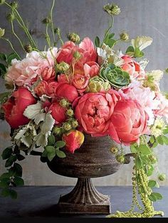 Pink flowers in weathered French urn