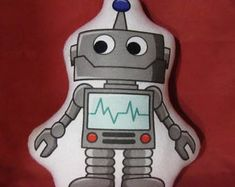 Check out our robot pillow selection for the very best in unique or custom, handmade pieces from our shops. Robot Clipart, Baby Pillows, Plush, Nursery, Clip Art, Shapes, Rock, Christmas Ornaments, Holiday Decor