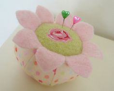 cute pin cushion...gonna make one of these....this trumps the regular red standard red strawberry pin cushion!