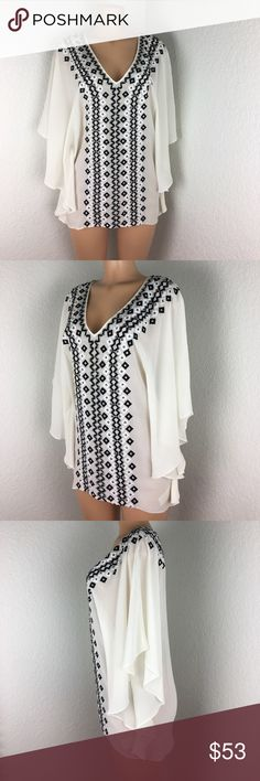 Alice + Olivia silk Beaded Blouse XS kaftan style Alice + Olivia creamy white 100% silk kaftan style loose flowing Blouse. Black and silver beading along front and back. Excellent condition. Just dry cleaned with intent to sell. Fine fabrics quality and construction. Size XS build could easily got up to a medium depending on how you like it fit. Could double as a cover up at a finer beach destination. Alice + Olivia Tops Blouses
