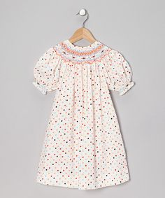 This Orange Polka Dot Lady Bishop Dress - Girls by Sweet Dreams is perfect! #zulilyfinds