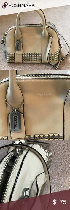 Tan Coach Purse Beautiful cross body purse that was much loved. Has one small tear on the handle but is fixable. Good condition. No trades! Coach Bags Crossbody Bags
