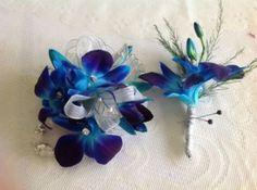 The Dendro Electric Blue Combo Matching Dendrobium Orchid Wrist Corsage & Boutonniere 820 South 8th Street, Historic District, downtown Manitowoc Email: info@thewildiris.net | 920-682-6194 | http://www.thewildiris.net/homecoming  ||  #TheWildiris #florists #flowers #Homecoming2015 #HomecomingFlowers #Manitowoc #ShopLocal (scheduled via http://www.tailwindapp.com?utm_source=pinterest&utm_medium=twpin&utm_content=post13638672&utm_campaign=scheduler_attribution)