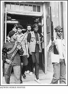 Thirty armed members of the Black Panther Party went to the California State Capitol to protest the Mulford Act, May 2, 1967.  Photo credit: World Wide Photos