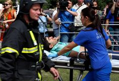 This photo shows one of the victims of the accident being taken to the hospital.