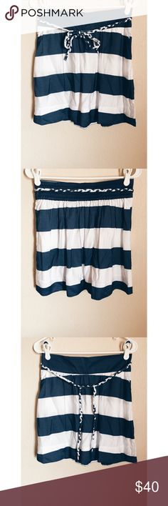 """Tommy Hilfiger navy and white striped skirt Tommy Hilfiger navy and white striped skirt with braided belt! Super cute nautical skirt! In great condition! Size Small Petite. Lovingly inspected for quality. Pictures show any signs of wear. Measurements: length 18.5"""" waist 15""""  Bundle up! Offers welcome :) Tommy Hilfiger Skirts"""