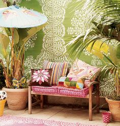 """Hang colorful outdoor (weather-resistant) rugs on walls or fences for instant """"wallpaper.""""  I want to paint a mural on the cinder block fence but this might be the instant fix I'm looking for.  (www.myhomeideas.com)"""