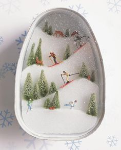 using several household items kids can create a snowy scene to depict their favorite things