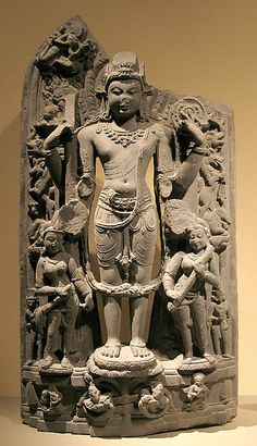 Standing Vishnu with His Consorts, Lakshmi and Sarasvati Period: Pala period Date: ca. second half of the 11th century Culture: India (Bihar) Medium: Black stone Dimensions: H. 36 1/2 in. (92.7 cm) Classification: Sculpture Credit Line: Gift of Michael V. Stolen, 1987 Accession Number: 1987.178
