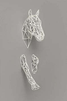 Equus Horse Sculpture from notonthehighstreet.com - I love the contrast of the white sculpture against the dove grey wall.