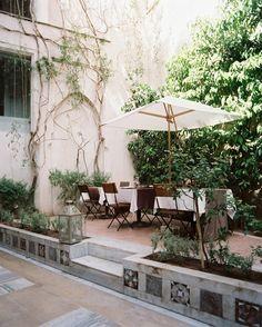 Garden Photo - An outdoor dining space