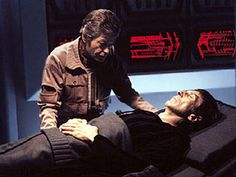 As the U.S.S. Enterprise returns to spacedock for repairs following the battle with Khan in 2285. Kirk continues to mourn Spock's death. McCoy suddenly enters the Vulcan's sealed quarters, babbling incoherently. Upon reaching Earth, McCoy is hospitalized....