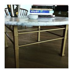 MODECOR designed antique marble and warm metal coffee table base. Anvil & Co. Manufacturing Ltd.