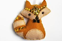 Check out this item in my Etsy shop https://www.etsy.com/listing/257761122/racoon-felt-ornament-golden-raccoon