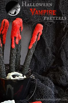 Halloween Vampire Pretzels | These bloody creations are perfect for any scary themed Halloween Party. With the perfect balance of sweet and salty no one with care that there is blood dripping down their pretzel.