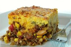 Chili meets casserole in this hearty Tex-Mex recipe. A flavorful chili filled with beans, green chilies, corn and spices is smothered in cheese then topped with a cornbread crust with even more green chilies for a savory pie the whole family will love! Th