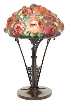 A Pairpoint reverse painted puffy glass and patinated metal Rose Bouquet lamp 1900 - 1925