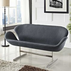 The Arne Jacobsen Swan sofa has a modern design. The contoured seating arrangement enhances the style and comfort of the sofa. This is replica of Swan Sofa
