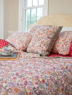 True treasures of the collection, our cotton quilts are much loved for their timeless beauty and peerless comfort. Detailed with a nifty velvet piping trim on the scalloped edge, the Nostalgia Quilt is double sided, reversible to a red and ecru block print. Designed to combine with matching pillowcases, embroidered pillowcases, and accent pillows for a sumptuous, soothing bedroom.