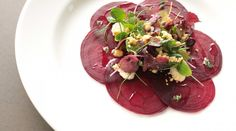 Elegance In Summer by Pierre  Beetroot salad served with goat cheese, parsley puree, candied walnuts and white balsamic
