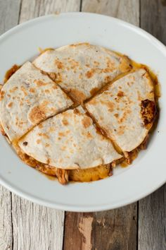 Teriyaki Chicken Quesadilla --- Don't knock it until you try it. There's something so delicious about teriyaki chicken stuffed in a gooey, cheesy quesadilla. Plus the kids love it, Win!! ohsweetbasil.com