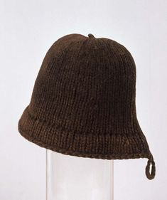 Monmouth Cap  Provenance: 16th century, Nelson Museum and Local History Centre  Fiber: two-ply wool  Colors:  Gauge: 2.5 stitches/inch  Technique: cast on at outer edge, knitted to the top, then stitches are picked up on the inside and knitted down to make a second inner layer for the brim, the edge is cast off with a 3-needle bind-off with the cast-on edge.  Description and Notes: 59 stitches around where the brim meets the crown,