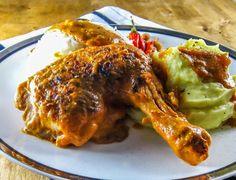 Democratic Republic of Congo national dish: Moambe Chicken (Poulet à la Moambé)