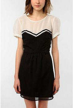 I love this dress because it looks as if your wearing a strapless dress over a sheer white blouse. It  gives it a really cute touch :)