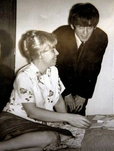 12th September 1964. George meets up with his sister Louise during The Beatles visit to Boston.