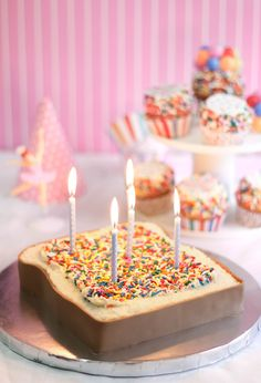 "Ramp your fairy bread up a notch by baking a massive slice of ""bread"" (okay, it's actually cake) and add a few candles on top for the most magical birthday cake ever."