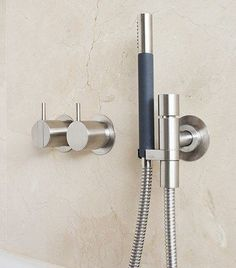 Let the VOLA 070 hand shower create drama and impact in your new design space # Bathroom Taps, Bathroom Inspo, Bathroom Fixtures, Bathroom Inspiration, Brushed Stainless Steel, Simple Lines, Bathroom Interior Design, Beautiful Bathrooms, Shower Heads