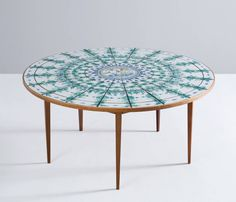Bjørn Wiinblad Signed Round Tiled Dining Table | From a unique collection of antique and modern dining room tables at https://www.1stdibs.com/furniture/tables/dining-room-tables/